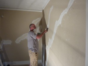 Repairing cracks in plaster walls
