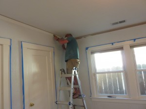 scraping paint from crown molding